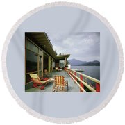 Two Women On The Deck Of A House On A Lake Round Beach Towel