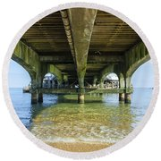 Under A Pier Round Beach Towel