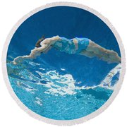 Underwater View Of Woman Diving Into Round Beach Towel