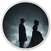 Victorian Couple Face On Another Before A Stormy Sky Round Beach Towel
