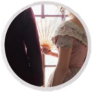 Victorian Couple Looking Out Of A Window Round Beach Towel