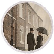 Victorian Couple On A Cobbled Street Round Beach Towel