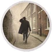 Victorian Man Running On A Cobbled Road Round Beach Towel