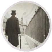 Victorian Man Walking Towards A Row Of Cottages Round Beach Towel