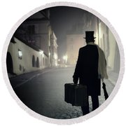 Victorian Man With Top Hat Carrying A Suitcase Walking In The Old Town At Night Round Beach Towel