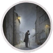 Victorian Man With Top Hat On A Cobbled Street At Night Round Beach Towel