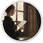 Victorian Or Edwardian Woman Reading A Letter By The Window Round Beach Towel