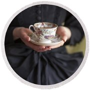 Victorian Woman Holding A China Cup And Saucer Of Tea Round Beach Towel