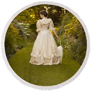 Victorian Woman In A Formal Garden Round Beach Towel