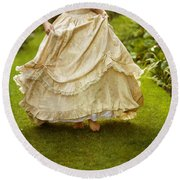 Victorian Woman Running On A Summer Lawn Round Beach Towel