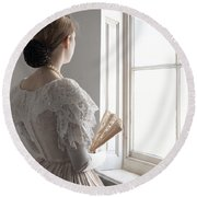 Victorian Woman With A Fan At The Window Round Beach Towel