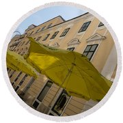 Vienna Street Life - Cheery Yellow Umbrellas At An Outdoor Cafe Round Beach Towel