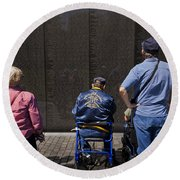 Vietnam Veterans Paying Respect To Fallen Soldiers At The Vietnam War Memorial Round Beach Towel