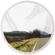 View Of Highway Running Through The Wilderness Of The Scottish Highlands Round Beach Towel
