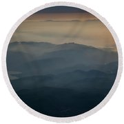 View Of Mountains And Clouds At Sunset Round Beach Towel