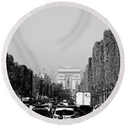 View Up The Champs Elysees Towards The Arc De Triomphe In Paris France  Round Beach Towel