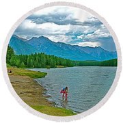 Wading In Johnson Lake In Banff Np-alberta Round Beach Towel