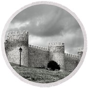 Wall Against Clouds Round Beach Towel