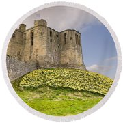 Warkworth Castle With  Daffodils Round Beach Towel
