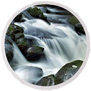 Water Flowsthrough The Mountains Round Beach Towel
