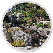 Water On The Rocks Round Beach Towel