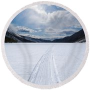 Well Used Winter Trail On Frozen Mountain Lake Round Beach Towel