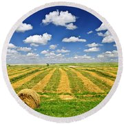 Wheat Farm Field And Hay Bales At Harvest In Saskatchewan Round Beach Towel