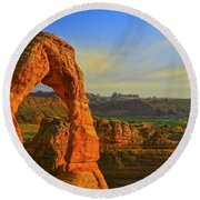 Whispy Clouds Over Delicate Arch Round Beach Towel