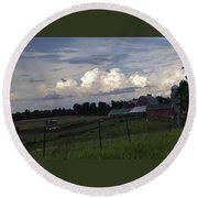 White Clouds Over The Farm Round Beach Towel