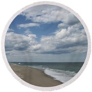 White Clouds Over The Ocean Round Beach Towel