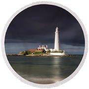 White Lighthouse Illuminated By Round Beach Towel