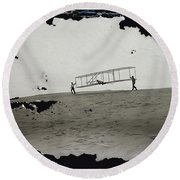 The Wright Brothers Wilbur In Motion At Left Holding One End Of Glider Round Beach Towel