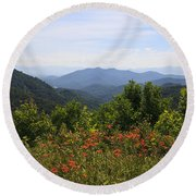 Wild Lilies With A Mountain View Round Beach Towel