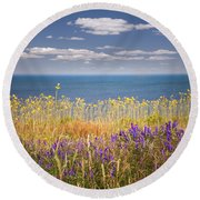 Wildflowers And Ocean Round Beach Towel