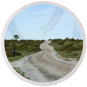 Winding Gravel Road Through A Landscape With Lots Of Junipers Round Beach Towel
