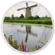Windmills Of Kinderdijk With Flowers Round Beach Towel