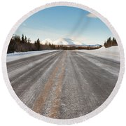 Winter On Country Road In Taiga And Snowy Mountain Round Beach Towel