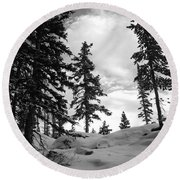 Winter Pines Silhouetted Against The Sky Round Beach Towel by Cascade Colors