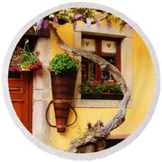 Wisteria And Yellow Wall In Alsace France Round Beach Towel