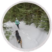 Woman And Dog Walking In Forest Round Beach Towel