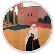 Woman At The Wall Round Beach Towel