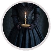 Woman In A Victorian Mourning Dress Holding A Candle Round Beach Towel