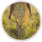 Woman In A Yellow Flowery Dress Walking In A Summer Meadow Round Beach Towel