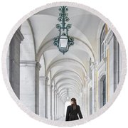 Woman In Archway  Round Beach Towel