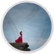Woman In Red Dress On A Clifftop Round Beach Towel