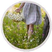 Woman Picking Flowers In A Wild Flower Meadow Round Beach Towel