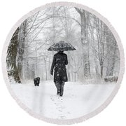 Woman Walking In A Snowy Forest Round Beach Towel