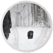 Woman Walking In The Snowy Forest Round Beach Towel