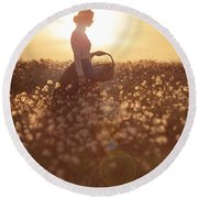 Woman With A Wicker Basket At Sunset Round Beach Towel