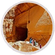 Women Leaving A Storage Place Near The Treasury In Petra-jordan Round Beach Towel